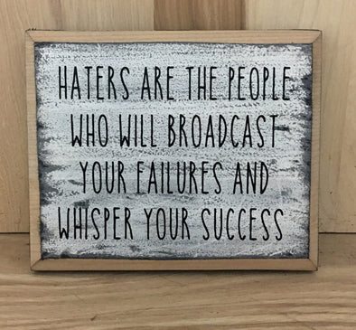 Haters wood sign with saying
