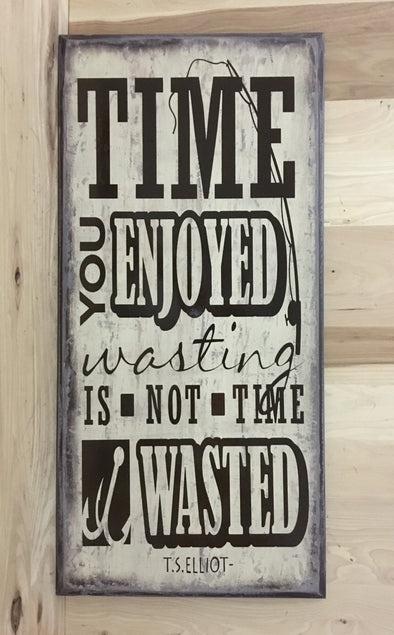 Time you enjoyed wasting is not tome wasted, T S Elliot quote on wood sign.