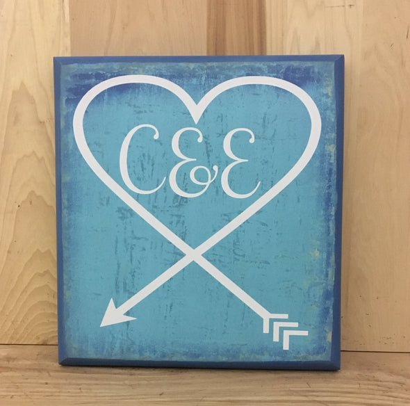 Personalized wedding sign with couple's initials.