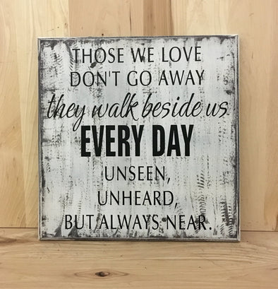 Those we love don't go away they walk beside us every day memorial sign.
