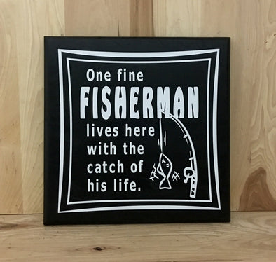 One fine fisherman lives here with the catch of his life fishing wood sign with fishing pole.