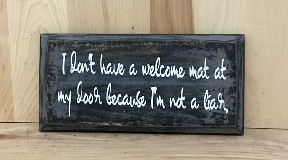 I don't have a welcome mat at my door because I'm not a liar wood sign.