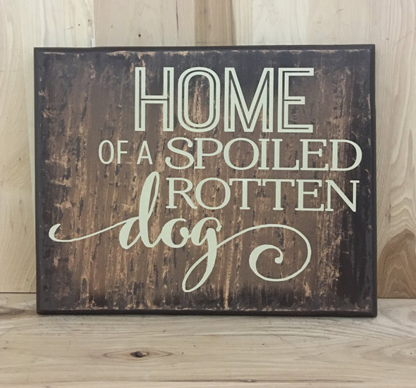 Home of a spoiled rotten dog wooden sign.