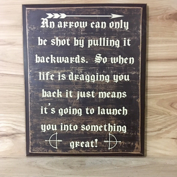An arrow can only be shot by pulling it backwards.  So when life is dragging you back