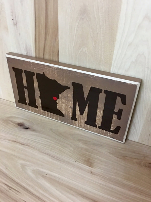 Personalized home wood sign with state shape.
