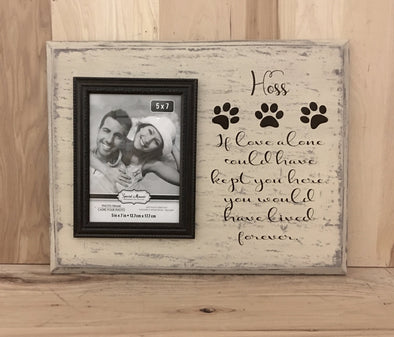 Personalized dog memorial wood sign with attached picture frame.