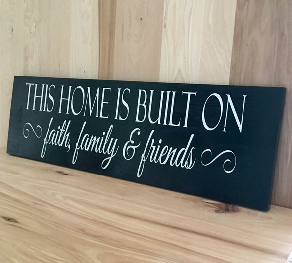 This home is built on faith, family & friends wood sign.