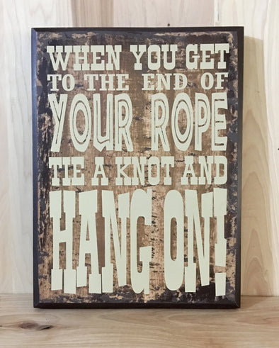 When you get to the end of your rope, tie a knot and hang on western sign.