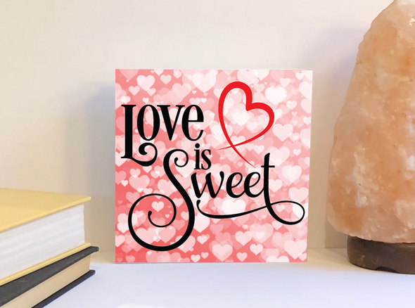 Love is sweet Valentine's Day sign.
