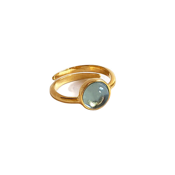 Light blue stone gold ring