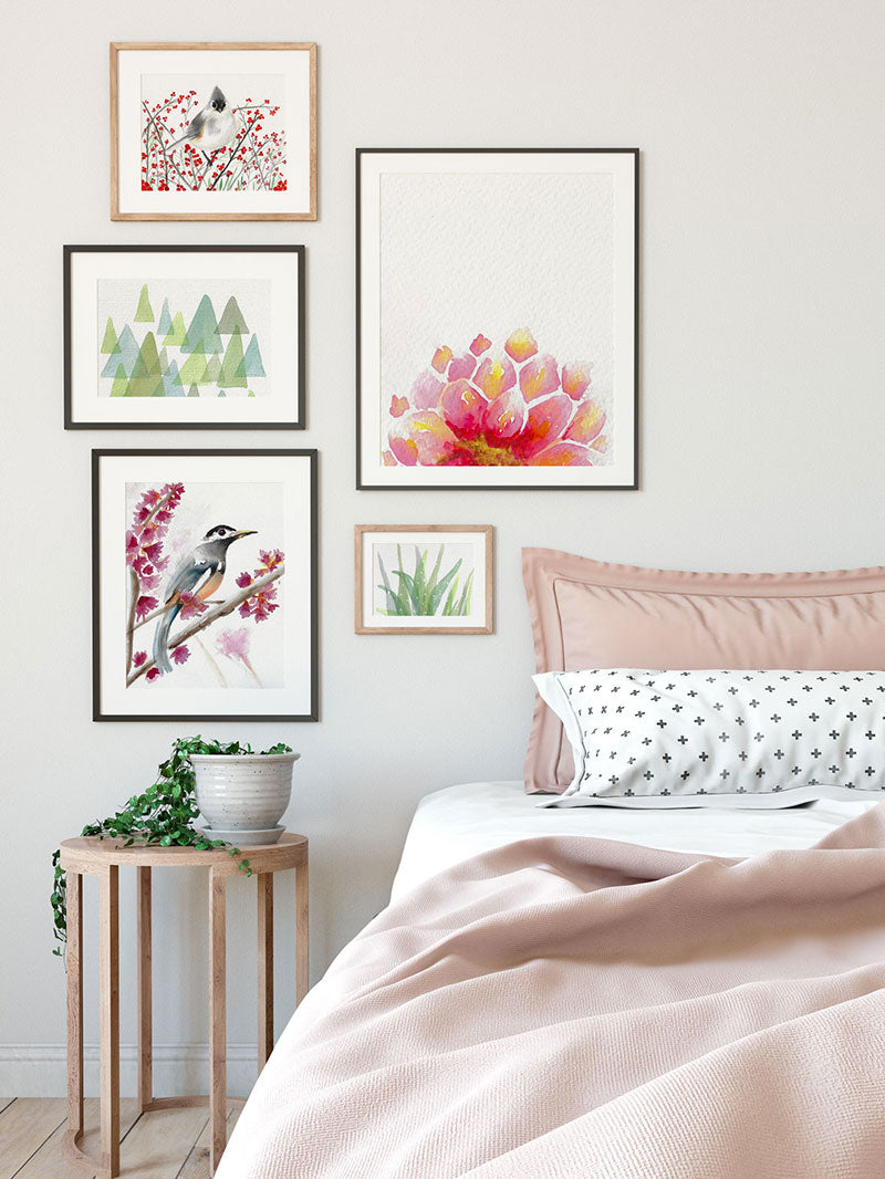 gallery wall of feminine pink watercolor prints hanging on bedroom wall - 7 ways art can improve your room decor