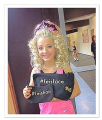 Irish dancer holding her Jigtastic feis accessory bags