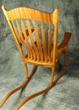 Mahogany and Zebrawood Sculpted Rocking Chair
