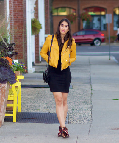 black dress with a pastel yellow jacket