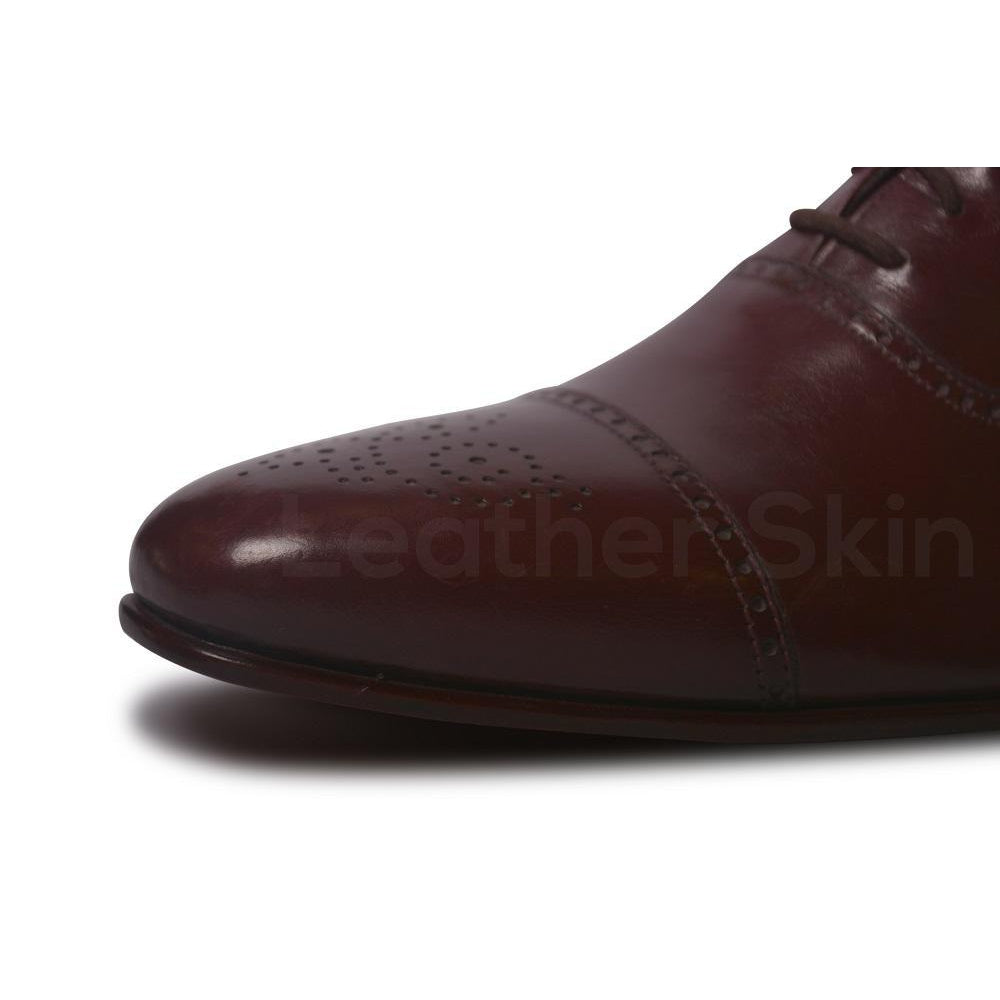 Brogue Design on Red Leather Shoe Toe