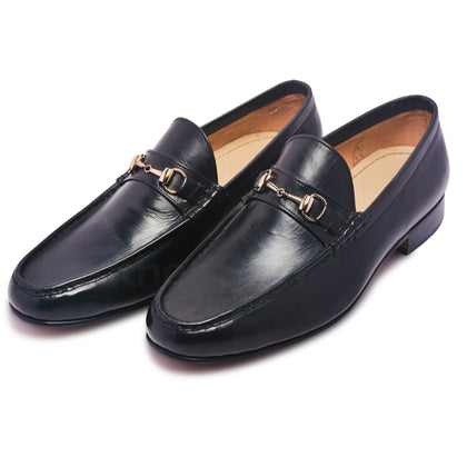 slip on black shoes with gold metal