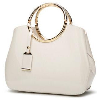 Women Shiny Glossy Faux-Leather Handbag with a Decorative Brass Buckle