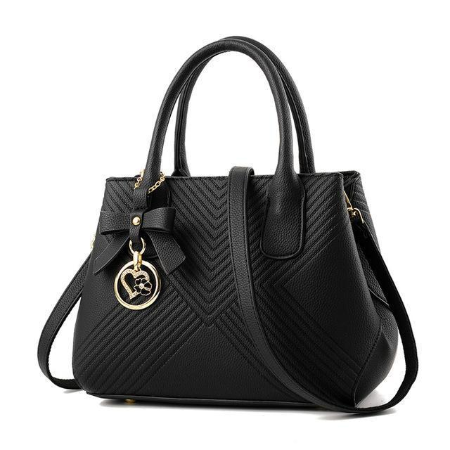 Women Quilted Faux-Leather Handbag with a Heart Shaped Tassel