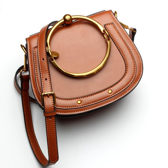 Women Saddle Faux-Leather Bag with Brass Buckle Design