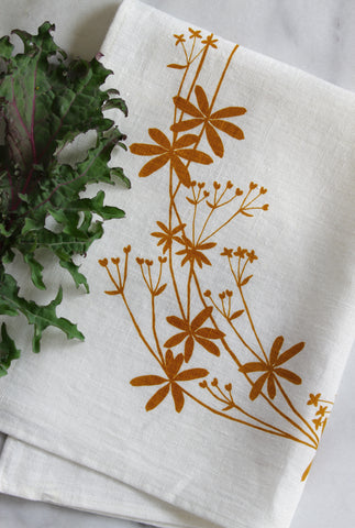 Bedstraw Kitchen Towel in Ochre on White Linen