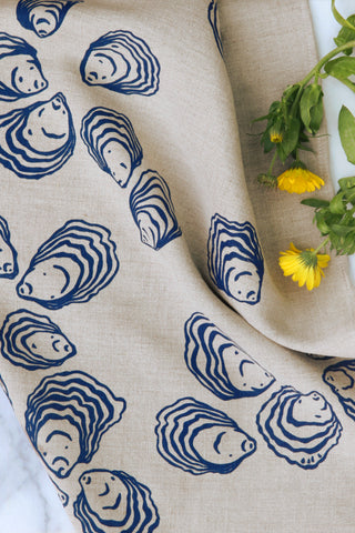 Oyster Kitchen Towel in Navy on Natural Linen