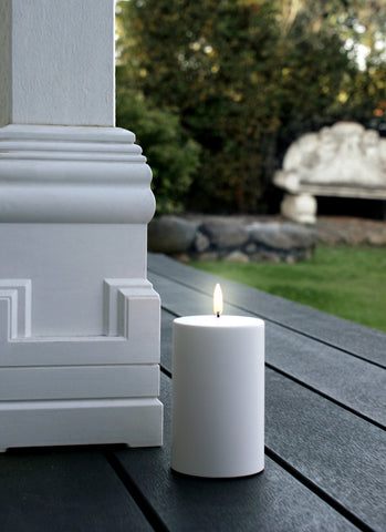 Weather resistant flameless candle on verandah