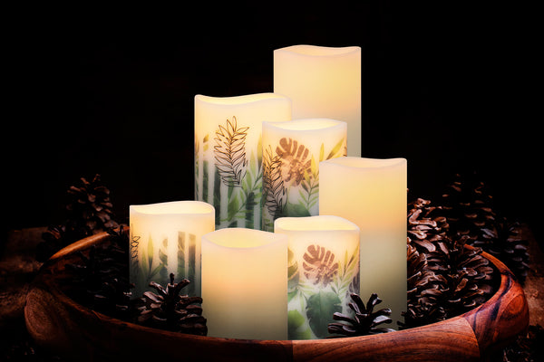 Flameless Candles set into a bowl with decorative greenery