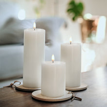 Load image into Gallery viewer, Trio of Uyuni flameless pillar candles on a table