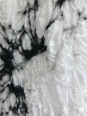 White base fabric with black and white wool fibers