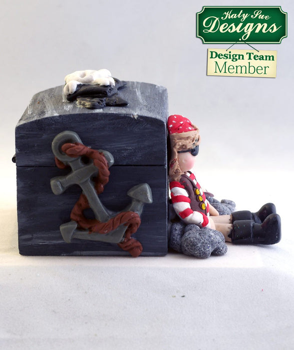 C - An idea using the Pirate Accessories Sugar Buttons Silicone Mould product