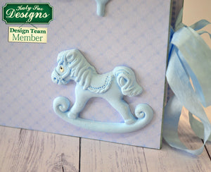 C - An idea using the Rocking Horse Sugar Buttons Silicone Mould product