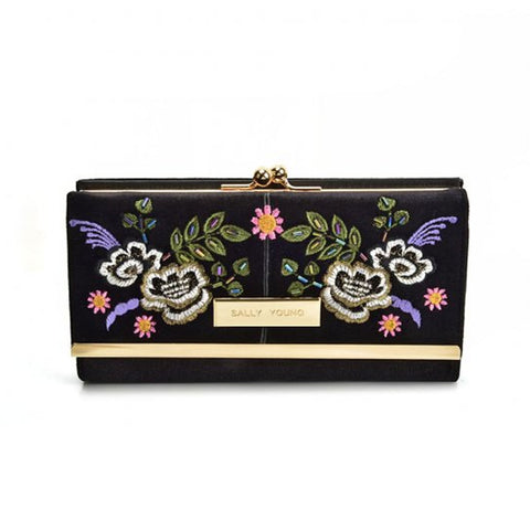 Black Fashionable retro style wallet with flower print design and gold detailing, compact clutch with press stud closure