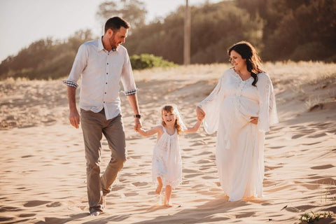 gorgeous pregnant plus size lady wearing the Fillyboo CLEO gown for her maternity photo shoot