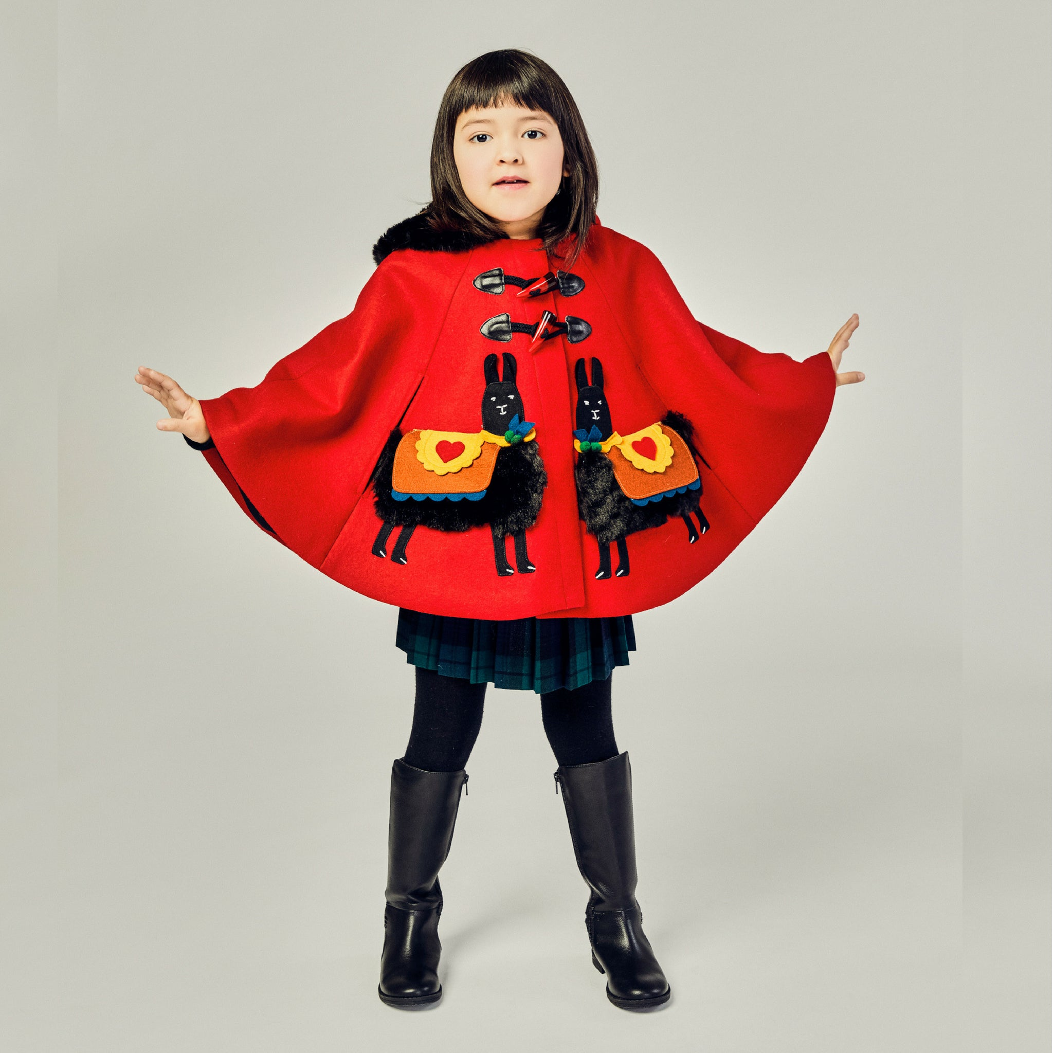 red wool cape with black llamas