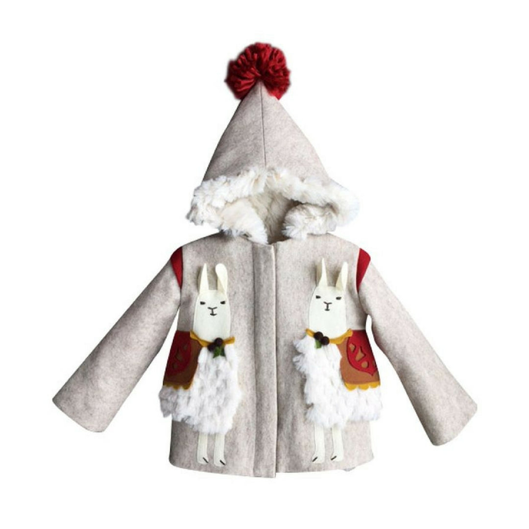 Two white llamas on tan wool coat with red pom pom on top of the hood.