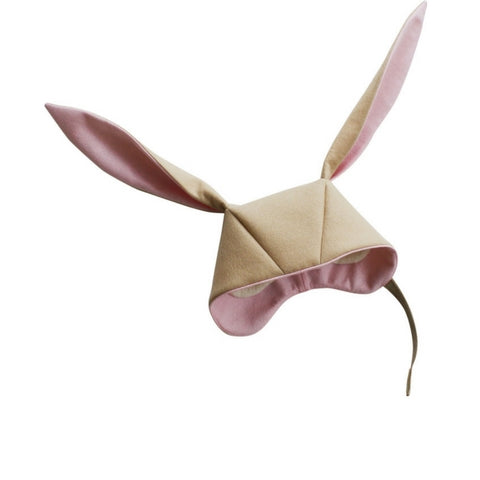 Light tan bunny hat with pink lining within the ears and rim of hood. White hat lining peaking through from inside the hat.
