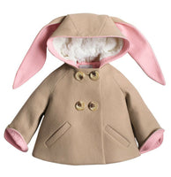 Tan bunny coat with pink lining on the ears and cuffs and white polyester body lining.