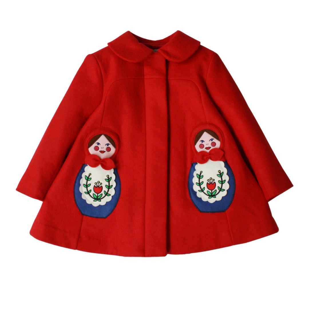 red wool coat with collar and hidden buttons beneath placket with two embriodered matryoshkas on left and right side of coat