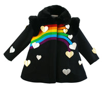 Black dress coat with a rainbow across the chest and hearts scattered across the end of the rainbow and scattered on both sides of the coat. Completed with a black faux collar and shoulder pads.