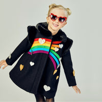 Model showing front of black coat, dissplaying the full rainbow with silver and gold hearts.