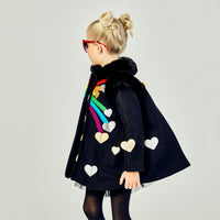 Left view of black coat, displaying the ends of the rainbow stopped by hearts. along with a heart on the sleeve and towards the back of the coat.