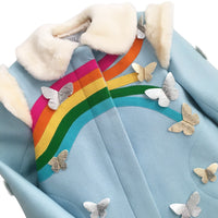 Closeup on the blue coat, displaying the rainbow with different sized butterflies at the end of each color.