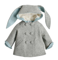 light grey coat with bunny ears on the hood and white lining within the hood. The body is completed with light blue lining and six grey buttons, in pairs, down the front.