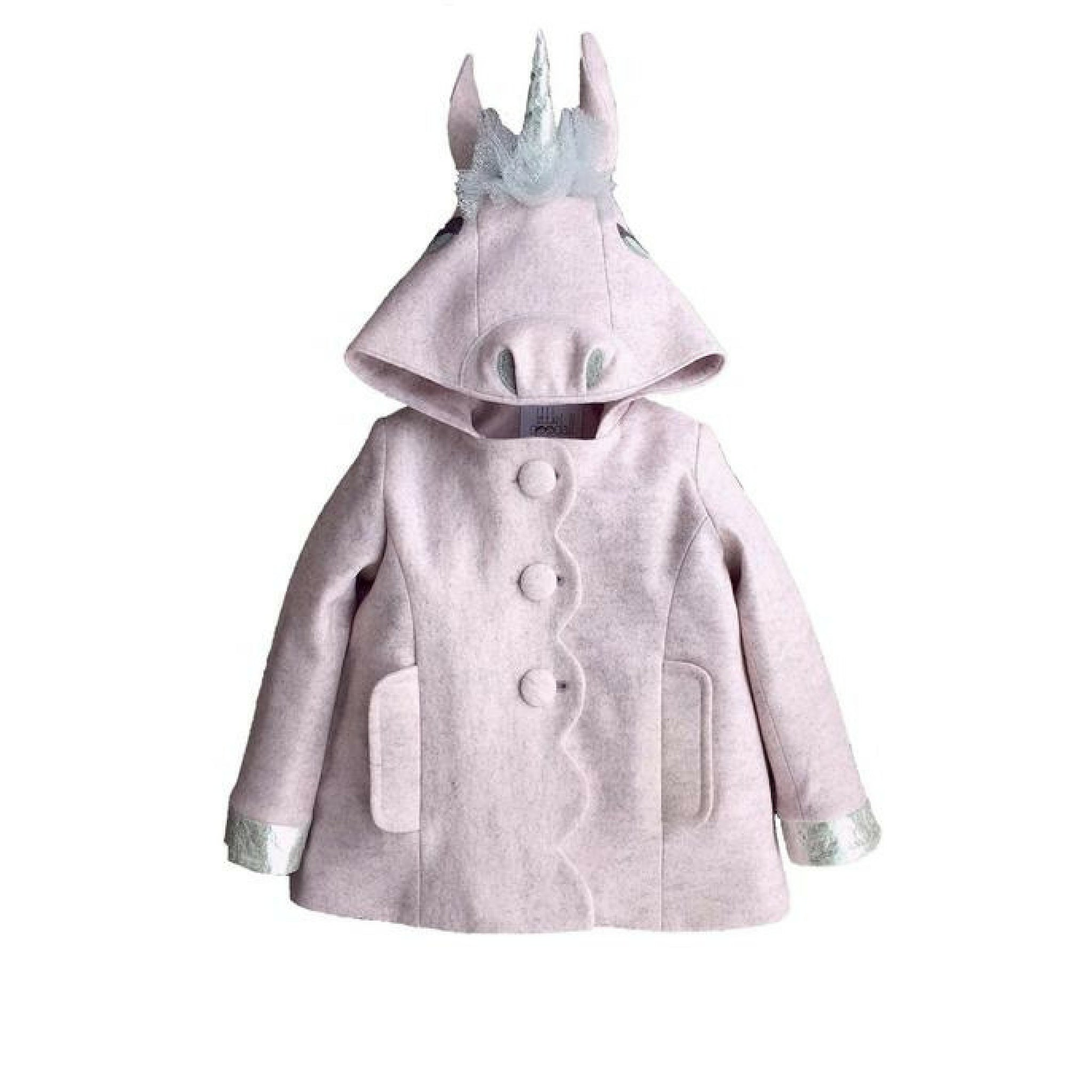 Light pink wool felt dress coat with a scallop closing secured with three buttons. Featuring a unicorn hood with a silver tool mane and horn, along with silver wool felt cuffs at end of sleeves.