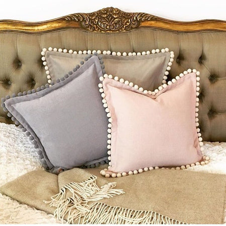 Country style cushions with pompoms