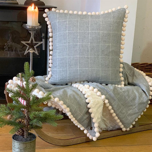 Country style cushion with pompoms
