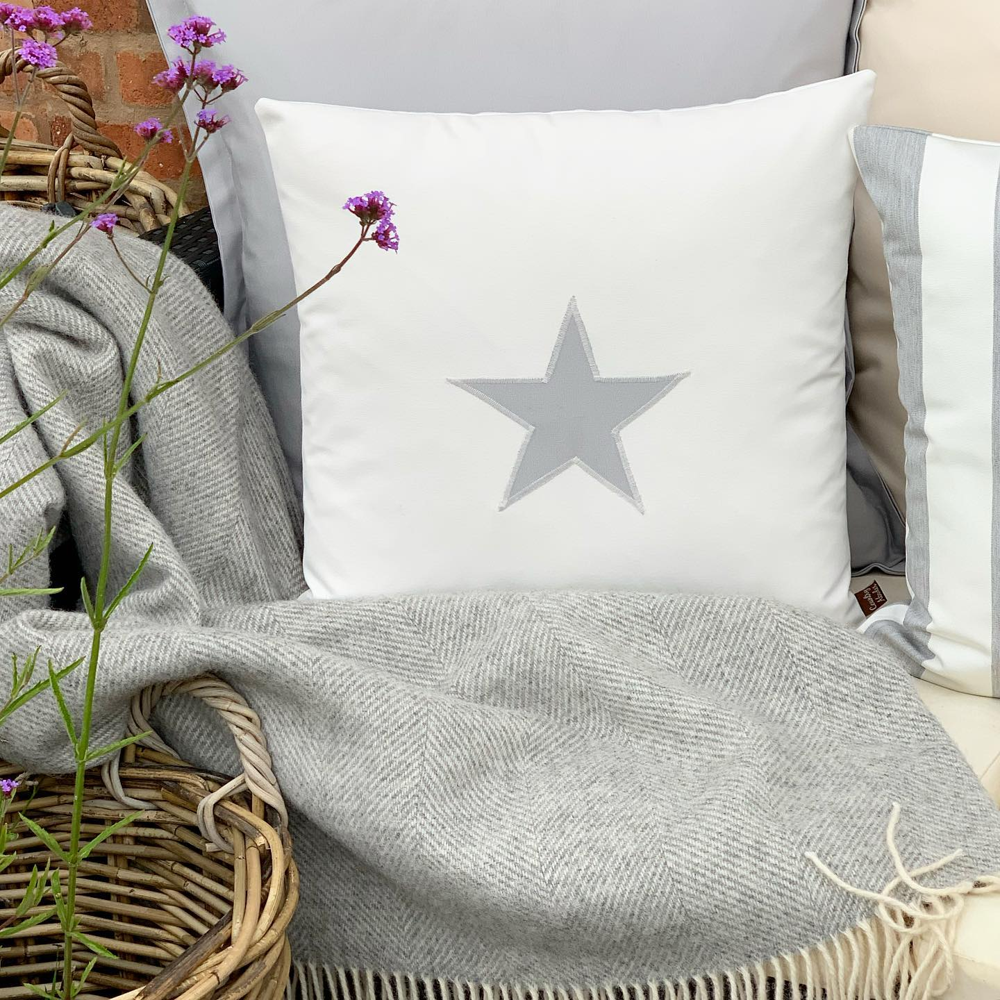Water Resistant Star Appliquéd Cushion