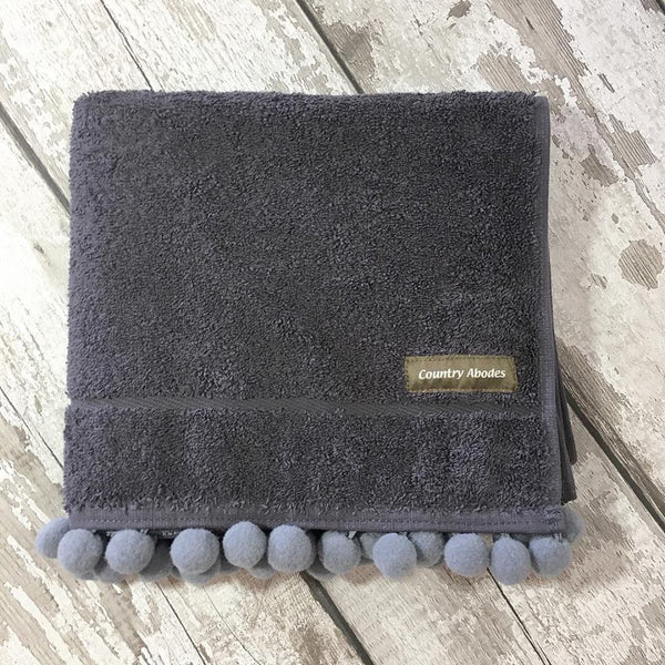 Bath Mat with pompoms by Country Abodes