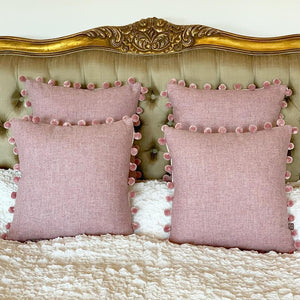 Pink Tweed cushions with pink pompoms