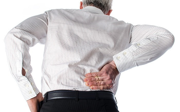 elderly man leaning over with back pain